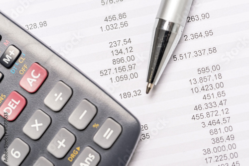 Documents with calculator and pen - 111088633