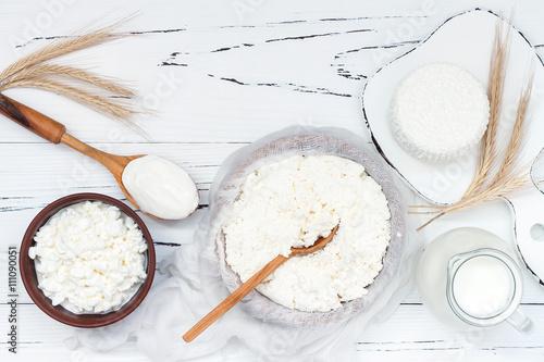 Fotografie, Obraz  Soft homemade fresh ricotta cottage cheese made from milk, draining on muslin cloth