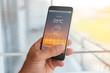 Leinwandbild Motiv Smart phone with weather forecast