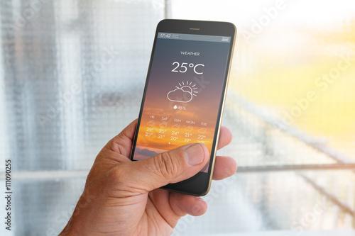 Obraz na plátne  Smart phone with weather forecast