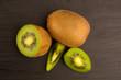Kiwi fruit on brown wooden background.