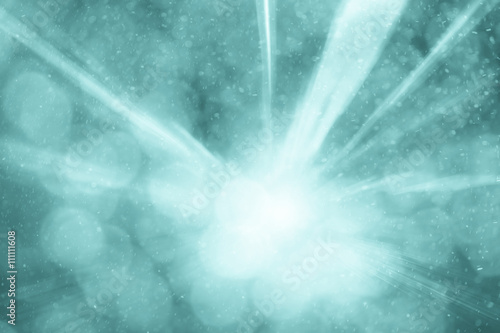 Photo  Cyan colored abstract blurred light rainfall bokeh background