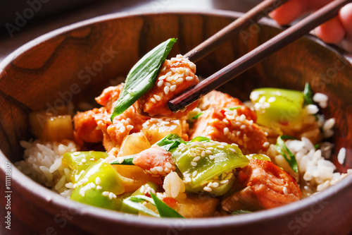 Asian cuisine - rice in sauce with stir fried vegetables, pineapple and salmon Wallpaper Mural