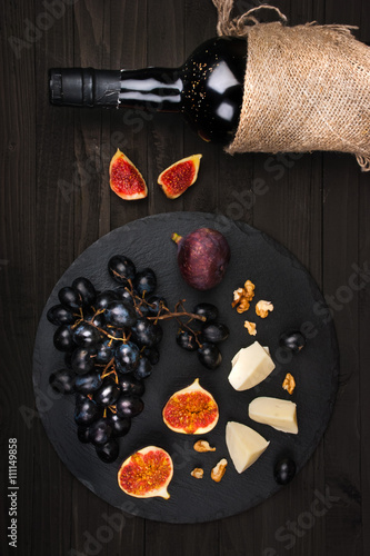 Food background with red wine, figs, grapes Poster