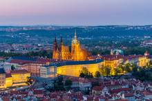 View Of Prague Castle With St. Vitus Cathedral From Petrin Tower At Blue Hour, Czech Republic