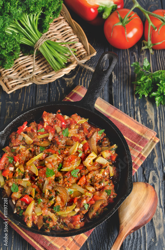 Vegetable ratatouille baked in cast iron frying pan