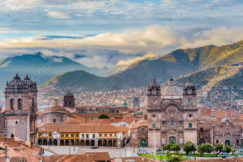 Spoed Foto op Canvas Zuid-Amerika land Morning sun rising at Plaza de armas, Cusco, City