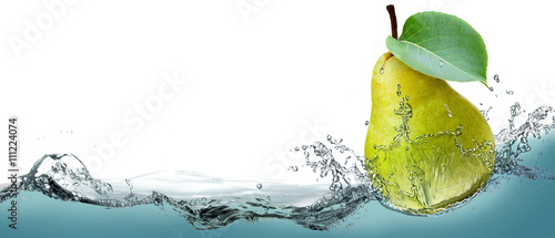 The fruit of a ripe pear on a background of splashing water. Wallpaper Mural