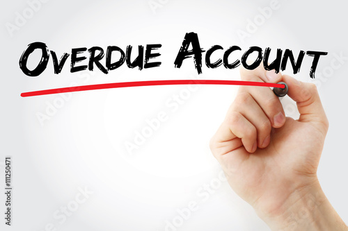 hand writing overdue account with marker business concept background
