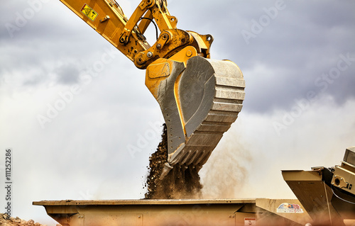Construction industry excavator feeding portable quarry machine Wallpaper Mural