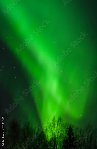 Photo  Cone of green aurora light