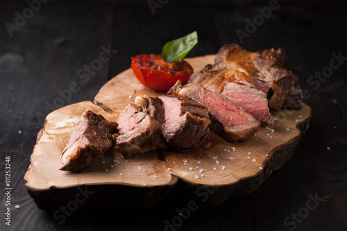 Fotografia  Sliced medium rare grilled Black Angus Steak Ribeye