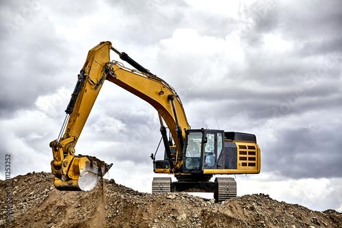 Fotomural  Constuction industry excavator heavy equipment moving gravel fil