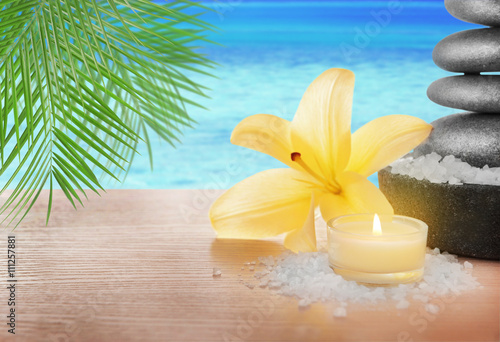 Fototapety, obrazy: Spa stones with lily, candle and sea salt on seascape background