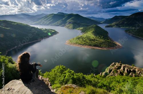 Fototapeta woman meditating relaxing alone Travel healthy Lifestyle concept lake and mounta
