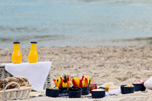 Keuken foto achterwand Picknick Summer picnic on the beach. Serving picnic utensils blue with ve