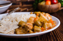 Ragout With Chicken And Okra Or Bamia Or Lady Finger In White Bowl On Wooden Background. Selective Focus