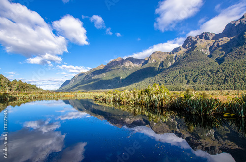 Reflection of Earl Mountains on the Mirror Lake which is located at the Milford Road,it is one of the New Zealand's great scenic routes.