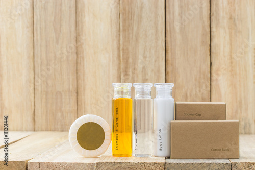 Tubes of bathroom amenity contains on wooden background Wallpaper Mural