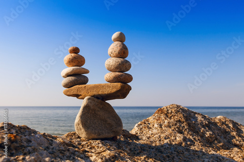 Zdjęcie XXL Concept of harmony and balance. Balance stones against the sea.