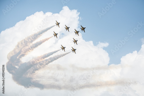 Show of force jets, planes carry a figure on a background of clouds, wallpaper w Fototapeta