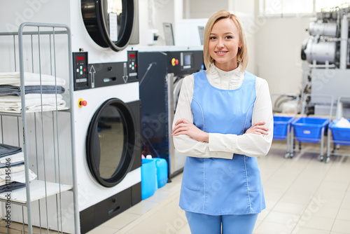 Printed kitchen splashbacks Artist KB Portrait of a smiling female worker in Laundry service