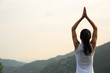 young fitness yoga woman at mountain peak..