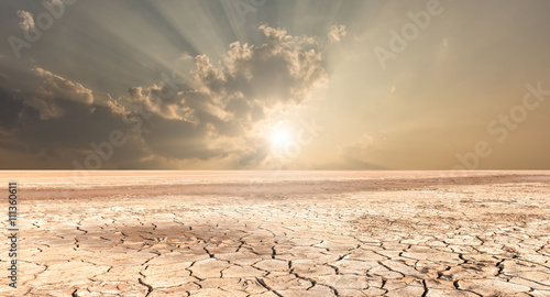 Soil drought cracked landscape sunset Poster Mural XXL