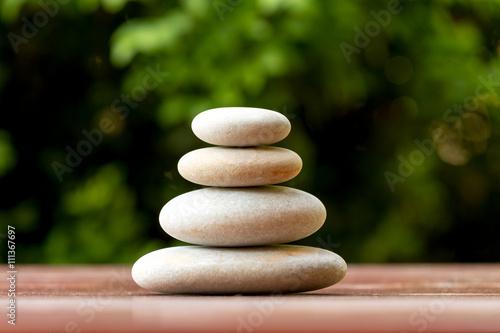 Montage in der Fensternische Zen Pile of balancing pebble stones outdoor
