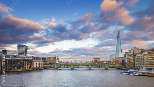 London skyline at sunset from Millennium Bridge with Tower Bridge, Shard and other famous landmarks - London, UK - 111368627
