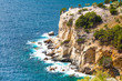 Panorama of seascape, waves and and rocky cliff coast line in Thassos Island, Greece