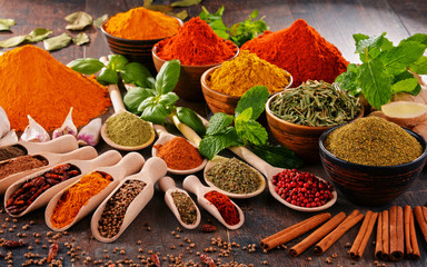 Fototapeta Przyprawy Variety of spices on kitchen table