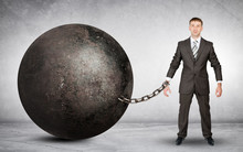 Businessman Chained To Large B...