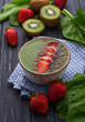 Smoothie bowl with spinach.
