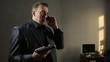 angry businessman waving his gun, said by telephone. threatening interlocutor