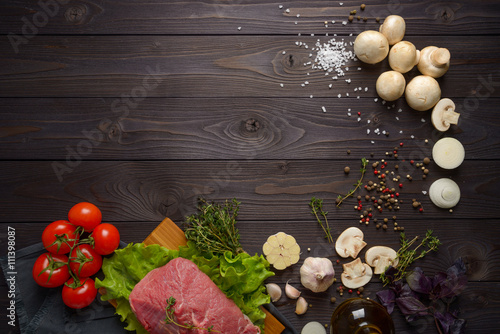 Staande foto Vlees raw meat with ingredients on a wooden background