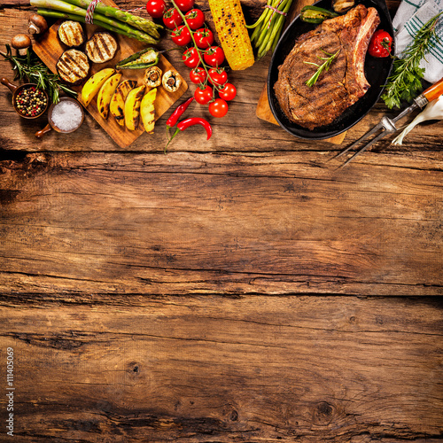 Aluminium Prints Grill / Barbecue Beef steak with grilled vegetables on wood