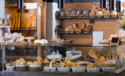 Fototapeta Display of ordinary bakery with bread and buns obraz