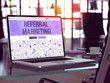 Referral Marketing - Closeup Landing Page in Doodle Design Style on Laptop Screen. On Background of Comfortable Working Place in Modern Office. Toned, Blurred Image. 3D Render.