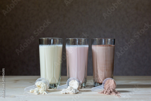 Three rest milk, chocolate, blueberry and banana drinks on table