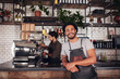 canvas print picture - Coffee shop worker smiling to camera