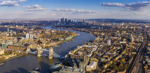 FototapetaLondon aerial skyline view including Tower Bridge with red Double Decker Bus, skyscrapers of Canary Wharf and River Thames