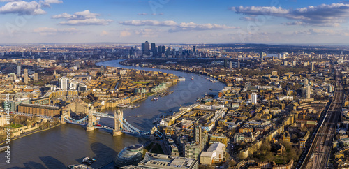 London aerial skyline view including Tower Bridge with red Double Decker Bus, skyscrapers of Canary Wharf and River Thames - 111449644