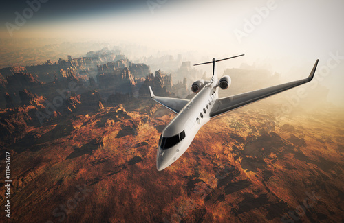 Fotografie, Obraz  Photo White Glossy Luxury Generic Design Private Jet Flying in Sky under Earth Surface