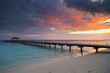 Awesome vivid sunset over the jetty in the Indian ocean.