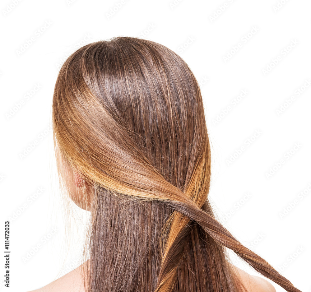 Photo  The girl with long brown hair braided strands of isolated.