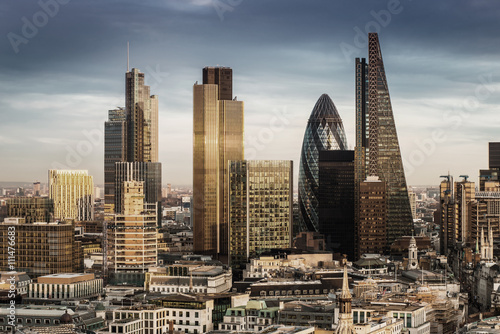 fototapeta na szkło London, England - Business district with famous skyscrapers and landmarks at golden hour