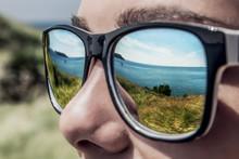 Sea Reflected In Man's Sunglasses