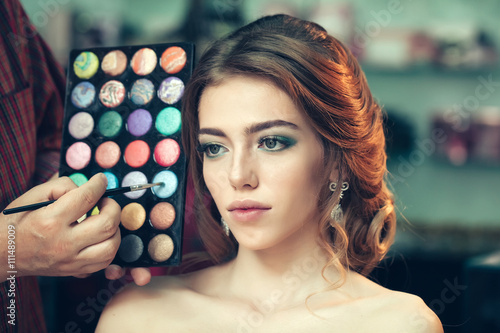 Pretty woman with makeup and palette Canvas Print
