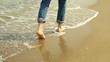 Young man walks at the beach